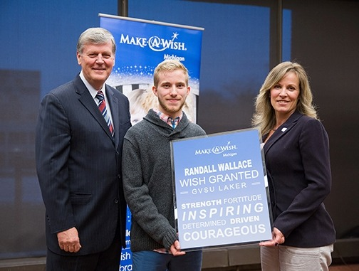 Pictured from left are Thomas J. Haas, Randall Wallace and Renae Wallace at a February ceremony marking Wallace's Make-A-Wish Michigan wish: tuition assistance to Grand Valley.